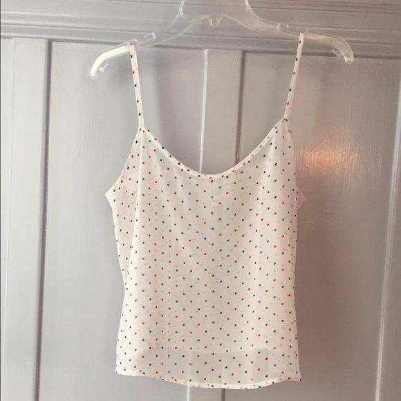 American apparel chiffon cami size small Super cute sheer chiffon cami from American apparel. Size small. white with blue and red polka dots. Slight mark on the front as shown in last photo, unnoticeable when worn. No tears or other marks. Clean and in great condition! American Apparel Tops Tank Tops