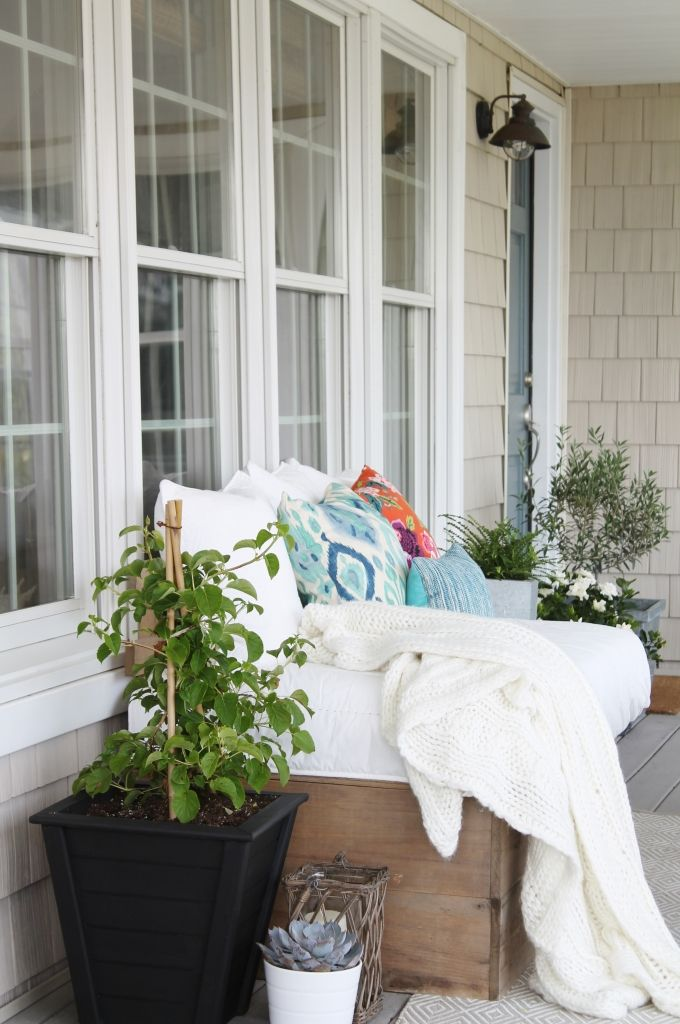 This porch from City Farmhouse is stunning! Check out her blog to see the full space featuring a fun ATG Stores hammock chair which perfectly complements this cozy and bright outdoor sofa.