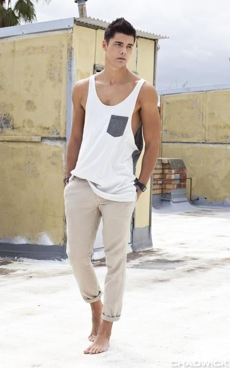 Shop this look for $28:  http://lookastic.com/men/looks/white-tank-and-beige-chinos/2636  — White Tank  — Beige Chinos