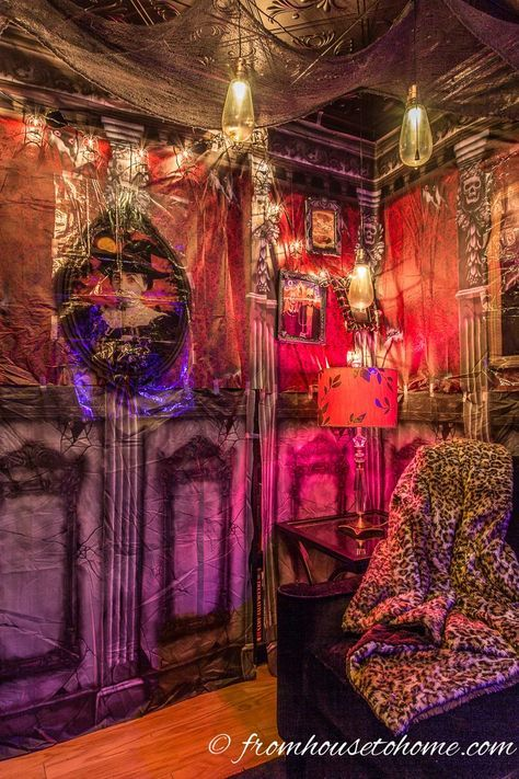This tutorial for hanging Halloween scene setters is the BEST! This haunted mansion scene setter changes the whole look of the room. I can't wait to try it for my Halloween party this year. Pinning!!
