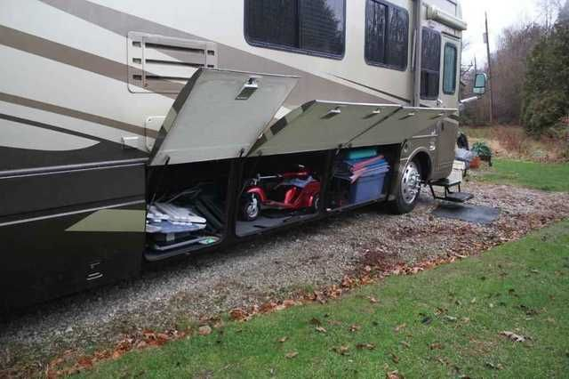 2002 Used National Tradewinds LTC Class A in Ohio OH.Recreational Vehicle, rv, 2002 National Tradewinds LTC, Beautiful clean coach. Non-smokers. 2 slides. Two flat screens TVs with new DVD players and a surround sound music system and TV antenna with booster. It has a direct TV satellite system with auto seek. Coach has washer/dryer, full size shower with tub and a six gallon gas/electric hot water heater. There are Corian counters, maple hardwood cabinets, and ceramic tile floor in kitchen…