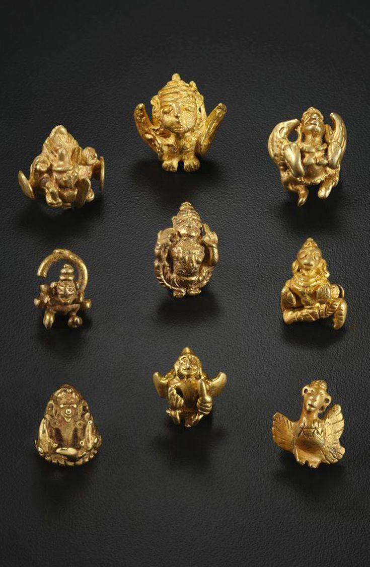 Guru Figure Ear Ornament mid 7th–10th century.  Gold; cast.   Java.