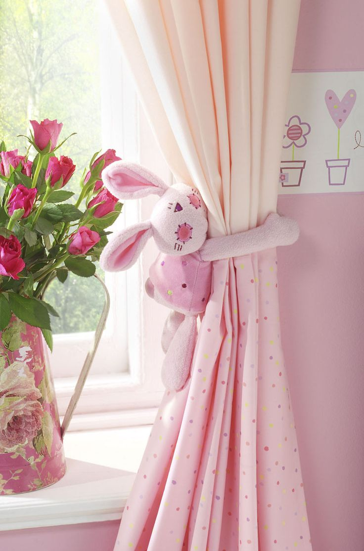 Adorable 'tie-back' for a little girl's curtains.