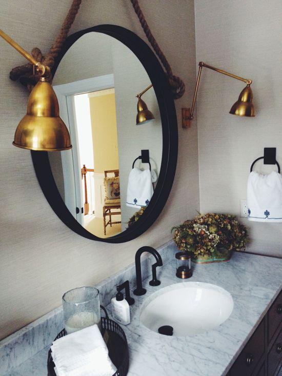 design manifest malvern bathroom round iron mirror and brass sconces