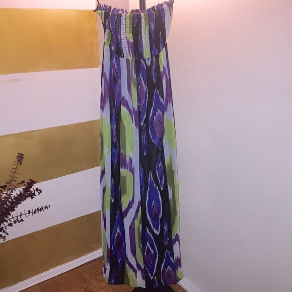 Maxi dress Purple, green, white, and black printed halter maxi. This dress is from the 2B BeBe brand. This beautiful strapless maxi is great for vacation when you simply do not feel like getting a full outfit together. Just throw it on and go! Worn once. bebe Dresses Maxi