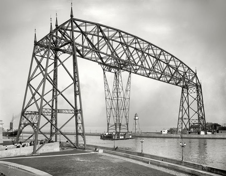 """Transporter Bridges: Useful or Just Beautiful?  The purpose of a bridge is to create connection between two shores across a river or other basin. Usually bridges do that by supporting railroads, automobile roads or pedestrian walkways. But there is a special kind of bridges called """"transporter bridges"""". What is so special about them? Instead of supporting railway or roadway, the transporter bridge carries a platform or a gondola across the river."""