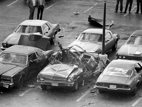 The Death of Danny Greene - Daniel Greene was killed by an assassin's bomb on October 6, 1977. After numerous unsuccessful attempts on his life, Greene met his end in the parking lot of his dentist's office at Brainard Place, Lyndhurst. The Chevrolet Nova in the center of the photograph, laced with explosives, was detonated by remote as Greene was entering his Lincoln (left). Image Courtesy of Cleveland State University.