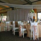 #ruffled #chaircovers #beige #Tablecloths #glass #candelabras #cystal #backdrop #fairylights #ceilingdrapery #chandelier