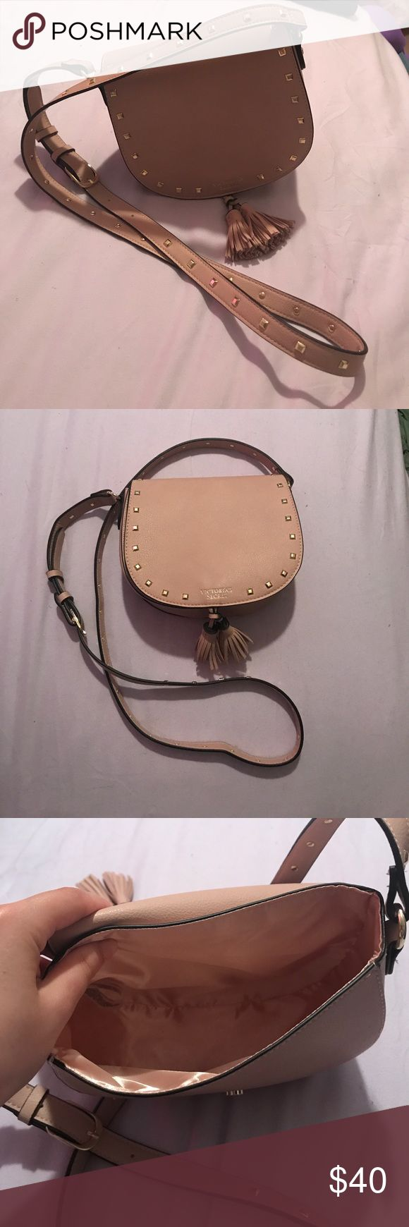 Victoria's Secret Festival Cross Body Bag Cute little cross body bag from Victoria's Secret! It is a creamy nude color with a magnetic closure, two cute tassels, and gold studs on front as well as along the strap. Plenty of room for a small wallet and phone! Victoria's Secret Bags Crossbody Bags