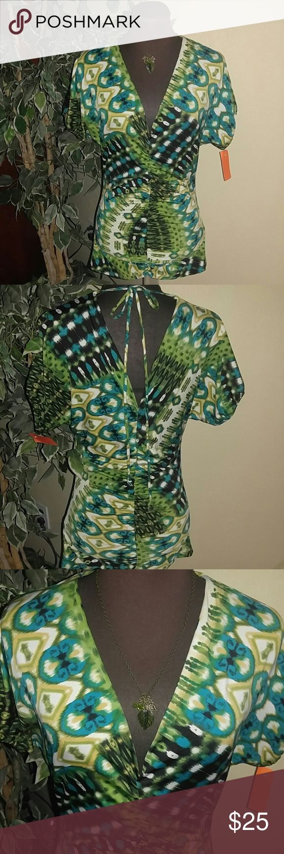 NEW LISTING! EUC MINI Dress or Tunic Top Greens, blues yellow and black Low VNeck both front and back. Has a Ruched bottom and tummy for that Sexy Look. Necklace is available in our jewelry dept. MKM Designs Tops