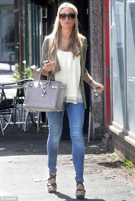 Alex Curran Gerrard in sleevless Elizabeth and James top, green jacket, Craft motorcycle jeans, grey (or taupe?) Birkin, and sandals.