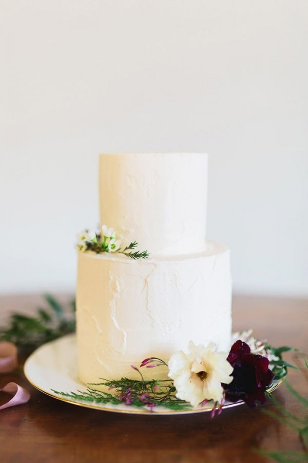 Simple Elegant Buttercream Wedding Cake with Fresh Flowers | Rustic White Photography | http://heyweddinglady.com/colorful-modern-fairy-tale-bridal-shoot/