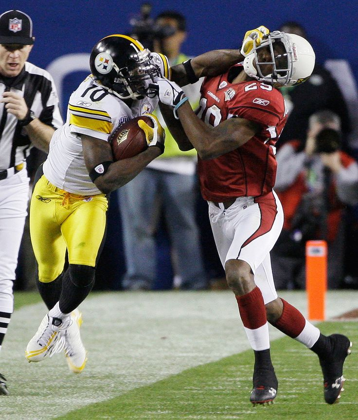 SB XLIII:  FEB. 1, 2009: Pittsburgh Steelers wide receiver Santonio Holmes, left, tries to fend off Arizona Cardinals defensive back Dominique Rodgers-Cromartie during the third quarter of Super Bowl XLIII in Tampa, Fla. Both teams relied almost exclusively on their passing games. The Cardinals led total offense by more than 100 yards, but the Steelers won 27-23, becoming the only team to date with six Super Bowl championships.