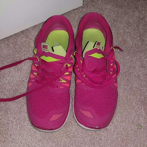 Red Nike running shoes Bought from another posher. I never used these theyre too big on me. Size 6.5womens but seller said they fit a size 6 womens better . Has a small white stain on the side of 1 shoes Not really noticeable. Nike Shoes Sneakers