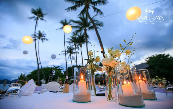 Candles in glass vases with sand