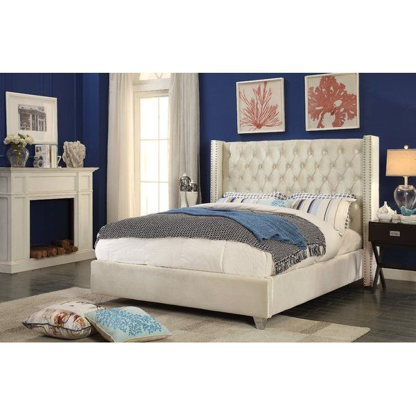 Elegant and eye-catching, the stunning Upholstered Platform Bed is the perfect addition to any bedroom. Rich velvet covers the deep tufted design. A beautiful wing bed design is complimented by hand applied chrome nailhead details. Strength and beauty is guaranteed with a solid wood frame and stainless steel legs.