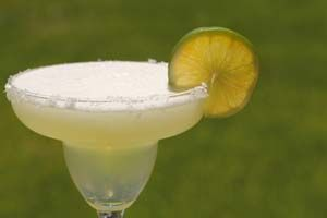 Applebee's Perfect Margarita  1 1/4 ounce Cuervo 1800 tequila 1/2 ounce cointreau 1/2 ounce grand marnier 1 1/2 ounce freshly squeezed lime juice 4 ounces sweet and sour mix 1/2 ounce simple syrup ***Garnish*** lime wedge olive