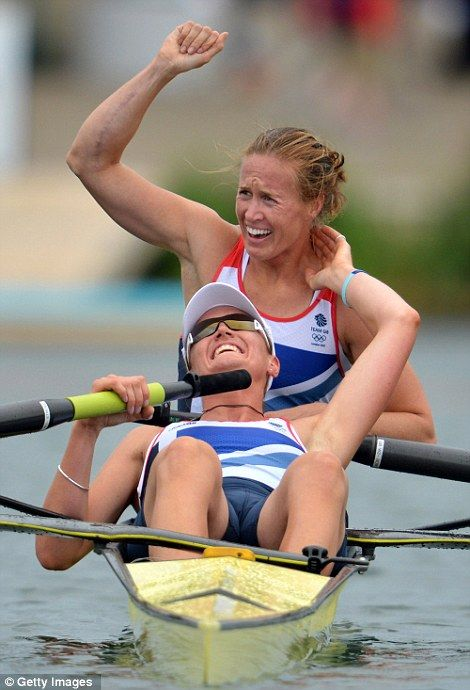 Helen Glover and Heather Stanning celebrate in their boat after winning Great Britain's first gold in the women's pair on day five