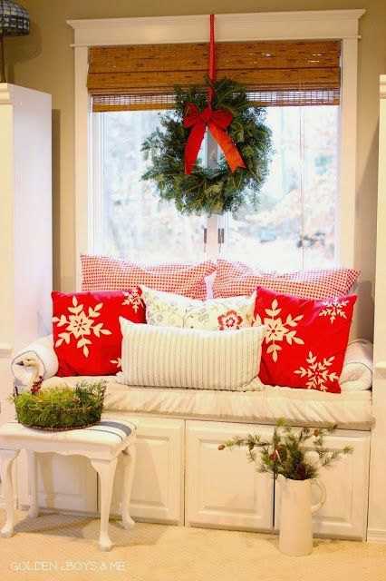 DIY Window seat created with off the shelf upper cabinets from Lowes with wreath and christmas decor in master bedroom-www.goldenboysandme.com
