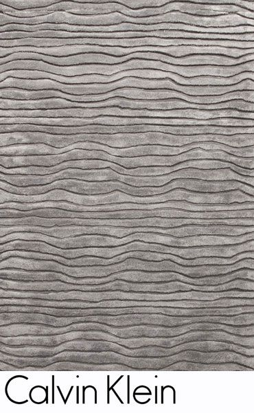 This modern type rug looks very rough. It also looks like the type of rug that would be used in bathroom mansions instead of small-time apartments.