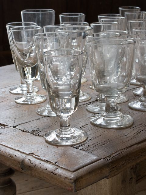 Antique wine glass on old wood