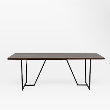 geometry angled iron legs provide the sturdy base for the geometric base dining table made from solid acacia wood in a rich dark walnut finish