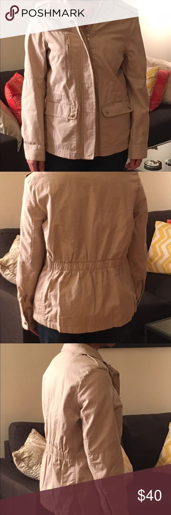 Beige zip up jacket Cream colored, zip up H and M jacket. Jacket has zip up packets as well as button pockets. Classic military design with a elastic band for the back for an easy stretch jacket also has a flat with buttons to cover the zipper. This is the H&M size 8. H&M Jackets & Coats