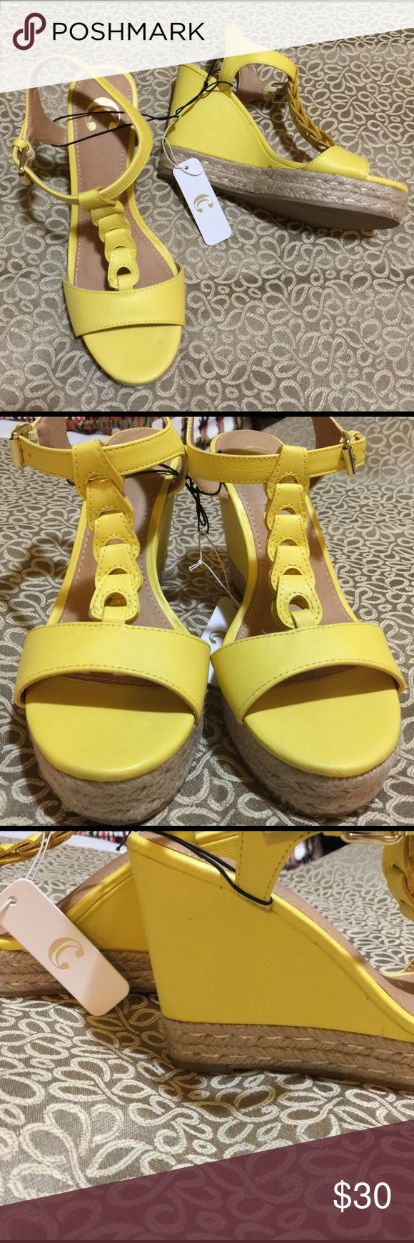"Yellow espadrille wedges size 7 Get ready for spring in these great espadrilles!!!  Bright yellow with ankle T strap. 4"" wedge with a 1"" platform. Never worn still have tags attached. Not sure of the brand, they just have a letter C inside. All man made materials. C Shoes Espadrilles"