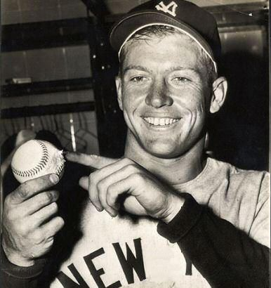 Mickey holding the historic ball after the game and pointing to the scrape that it sustained as it grazed off the metal sign on it's way out of the ballpark. April 17, 1953.