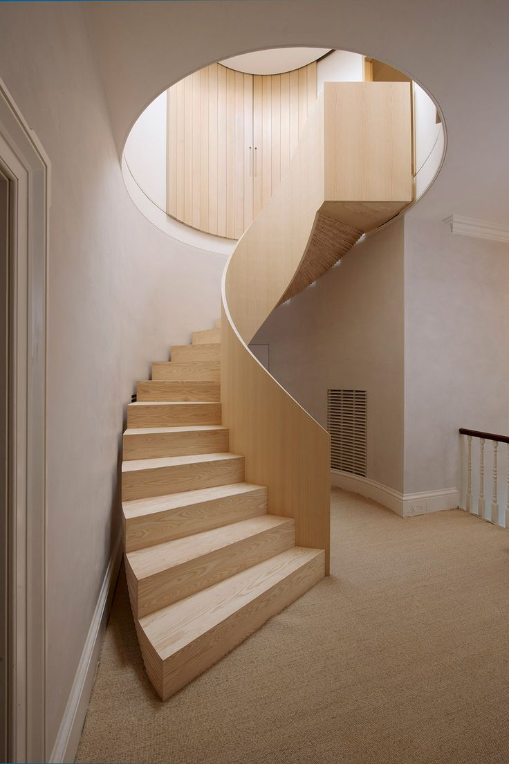 "CANT STAIR, formed with built up laminated of plywood. Each tread consists of 10 layers of ash ""Tri-ply"" which form a continuously fanned, twisted deck of cards like soffit,"