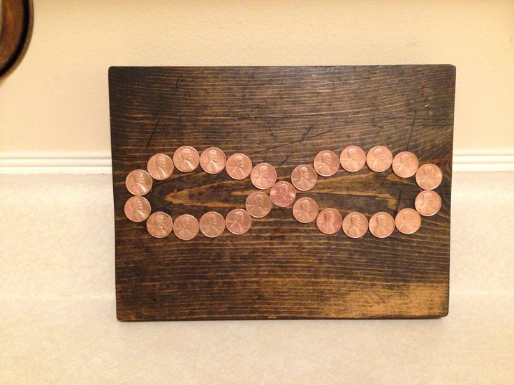 Made for my husband for our 8th anniversary. Left side is pennies with my birth yr right side from his birth yr. and the middle of the infinity symbol that connects them both is from the yr we married. Copper  is the 8th anniversary gift