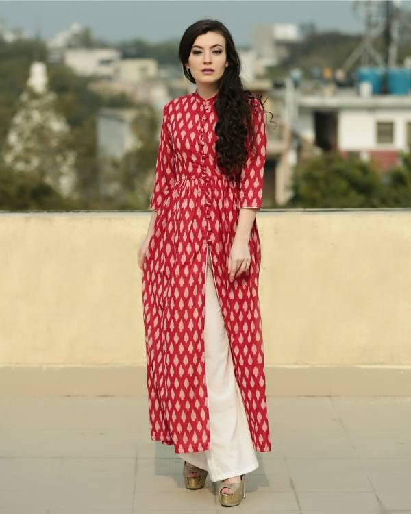 Scarlet ikat cape and palazzo set    The evergreen combination of red and off white in the form of a front slit cape. It comes with matching off white flared palazzo pants.