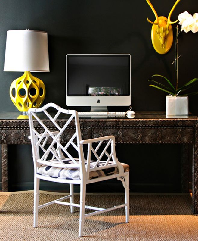 Sally Wheat Chic office space with bold black walls paint color, white faux  bamboo chair, Kenneth Wingard Yellow Truffault Lamp, ornate desk and orchid.