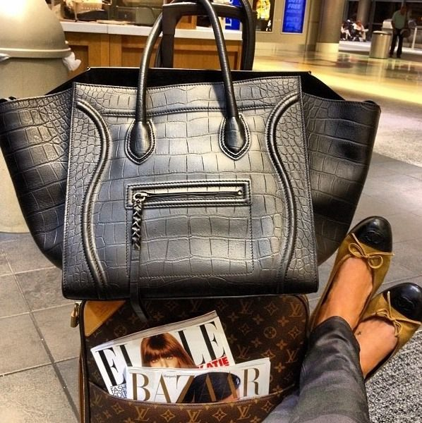 large black crocodile bag + Louis Vuitton monogrammed suitcase/luggage + black & tan Chanel flats