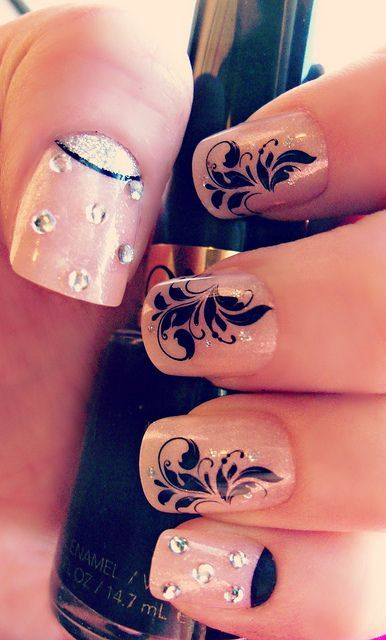 Channel the trend of the season with floral designs and a sheer nail paint! #Weddingnailart #Weddings