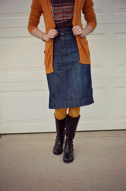 I want a jean skirt like this one. =) love the orange jacket for fall