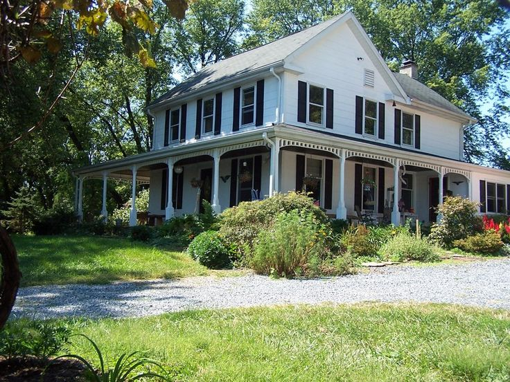 modern farmhouse with wrap around porch for sale