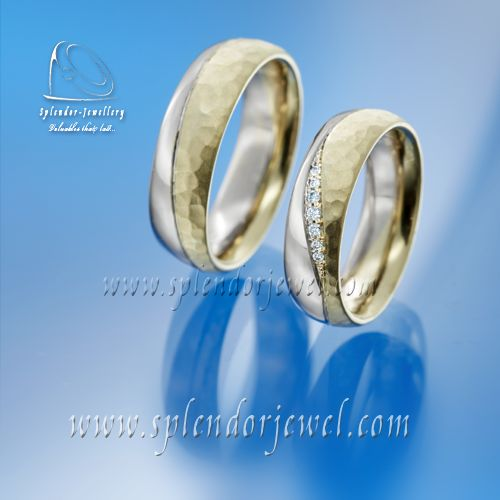 Yellow and white (palladium content) gold wedding bands with blue, briliant cut diamonds. Main feature of these wedding bands is the combination of hammered and shiny surface. If you are looking for an elegant and unique wedding bands which are durable and comfortable you might be interested to check our collection at www.splendorjewel.com.