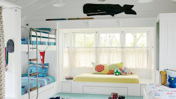 From the pretty painted floors to the quilt-inspired throw pillows and boat ladder lead-up to the top bunk, this coastal Massachusetts bunk is nonstop happy.