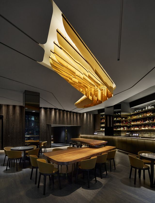 Modern Restaurant Interior Design | Love the Thick Wooden Table and the Hanging Ceiling Lights!