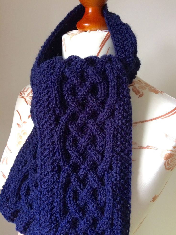 A personal favourite from my Etsy shop https://www.etsy.com/uk/listing/561385141/celtic-knot-knitted-aran-scarf