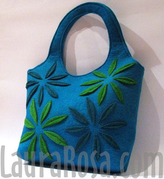 This ready to ship shoulder bag is made from thick 100% wool felt.    Its been designed, dyed, cut, embroidered and sewn by me.    Each item is one of a kind, I don´t repeat the colors or patterns.    Two tone flowers have been aplied on both sides of the bag.    The lining is heavy cotton canvas with strong interfacing.    For content organization it has a 6 x 6 inch inner zipper pocket.    To increase security it closes with two snap closures.    With handles included it measures 19 inches…