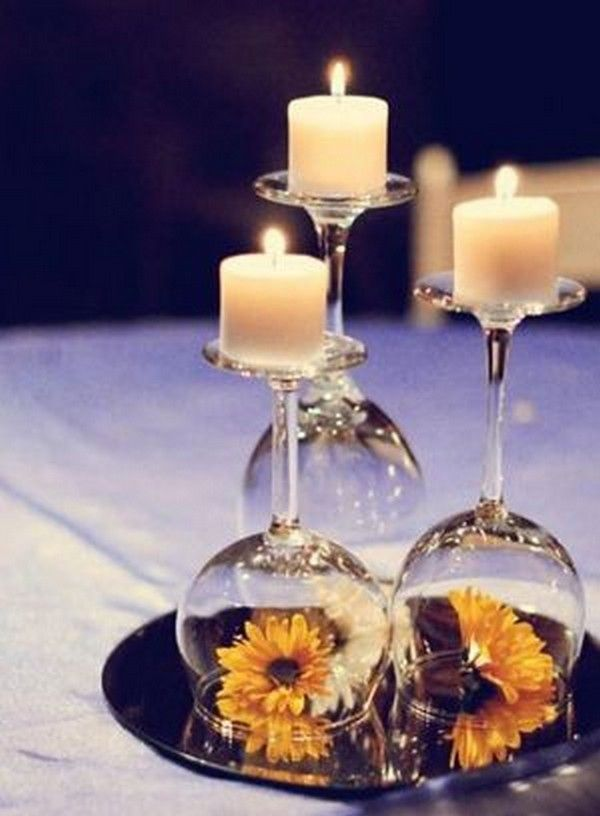 diy wedding centerpiece with candles and sunflowers