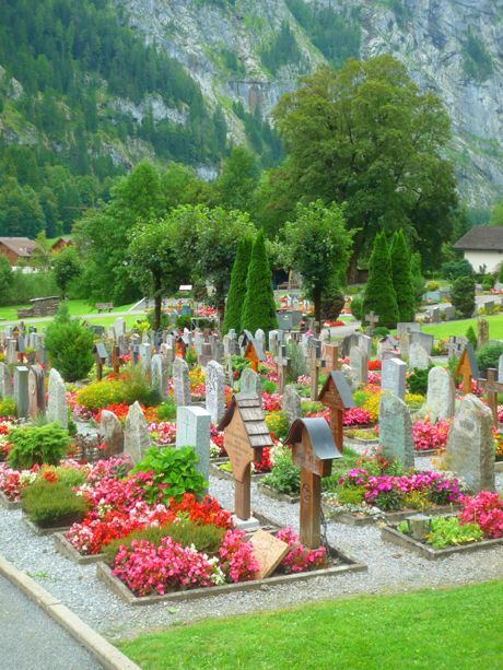 Flower beds filling each burial plot in cemeteries in Switzerland.