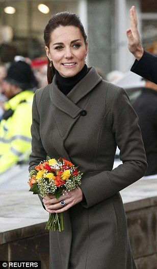 The Duchess of Cambridge wrapped up warm in an old Reiss coat from 2010...: