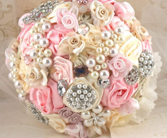 How cool...a homemade bouquet with satin flowers, pearls, and other pretty things.