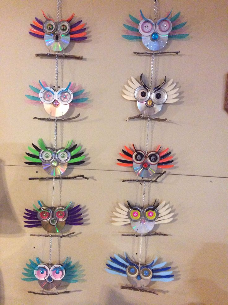 Cd owls I made with plasticware both sides have owl faces also check out the eyes