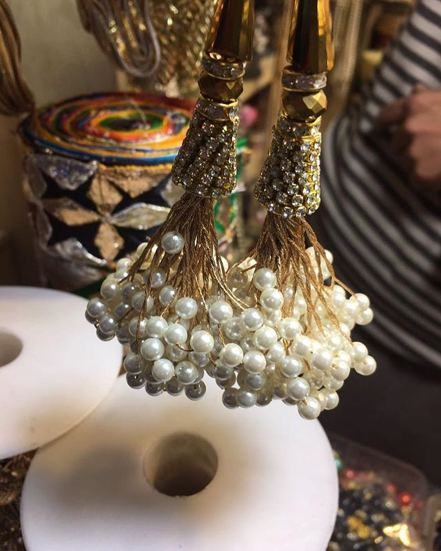 It's tassel galore at the studio these days! How awesome do these pearl studded tassels look with just the right amount of gold and bling accents!?!  #Avoir #bridals #weddings #bling #pearls #diamonds #gold #modern #style #pakistanifashion #pakistanibride #pakistanstreetstyle #desifashion #fashionbloggers #Lahore #Karachi #Islamabad #Pakistan #India #London #Berlin #Paris #worldwide