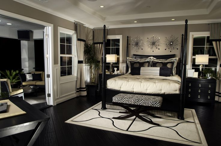 Elegant black and white bedroom design with splashes of zebra print (the bench at the foot of the bed).