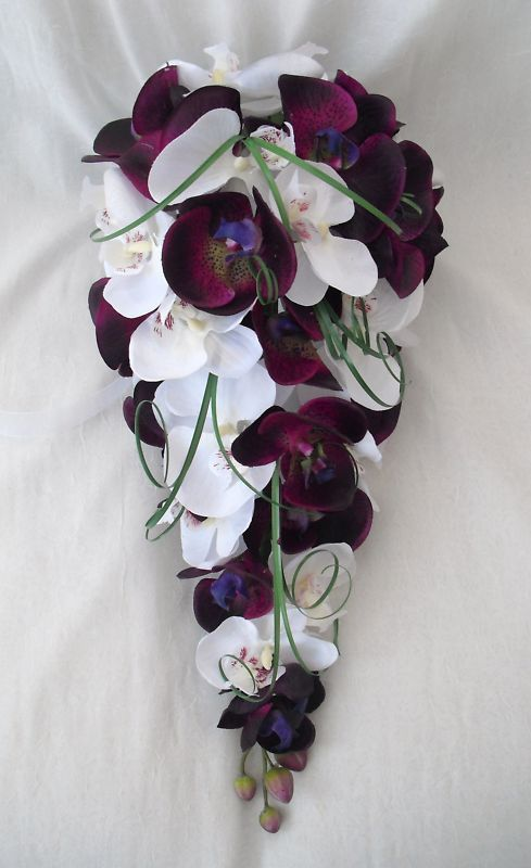GORGEOUS !...WEDDING FLOWERS - BRIDES ORCHID BOUQUET. Would look good with a few small Freesia's too !